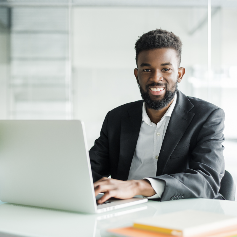 https://paltonmorgan.com/wp-content/uploads/2020/10/portrait-of-handsome-african-black-young-business-man-working-on-laptop-at-office-desk2.png